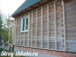 Установка обрешетки на деревянный дом