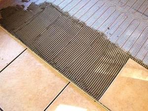 Укладка кафельной плитки на теплый пол