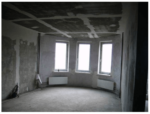 Жилье без отделки представляет собой коробку из бетона с голыми стенами