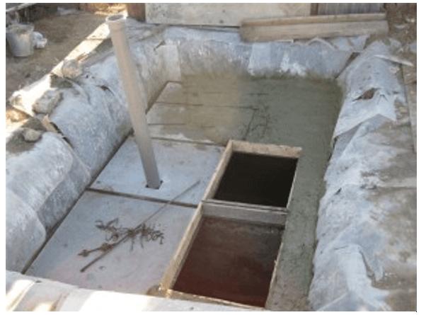 Готовый септик из бетона, построенный своими руками перед засыпкой